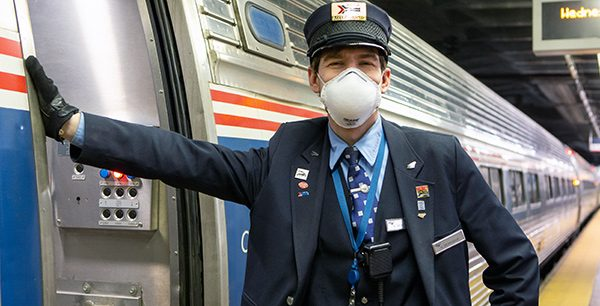 Amtrak employee wearing their face mask