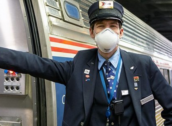 amtrak attendant in a facial covering