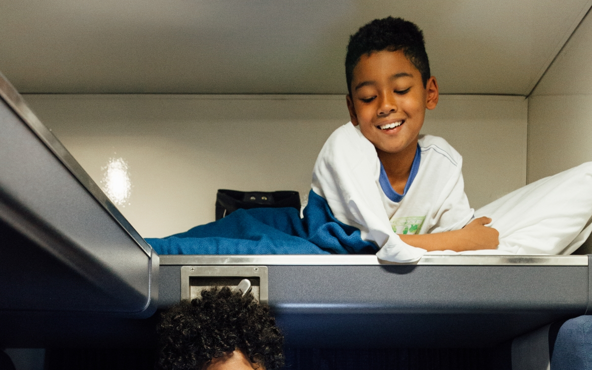 mom and son in amtrak private family bedroom