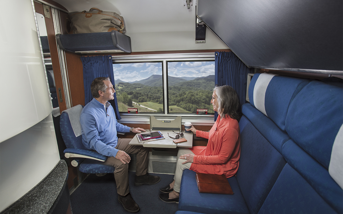 couple sitting in a private amtrak bedroom
