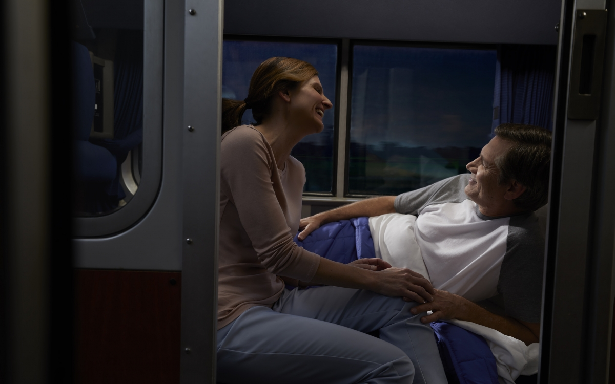 cute couple onboard amtrak's overnight private sleeping bedroom