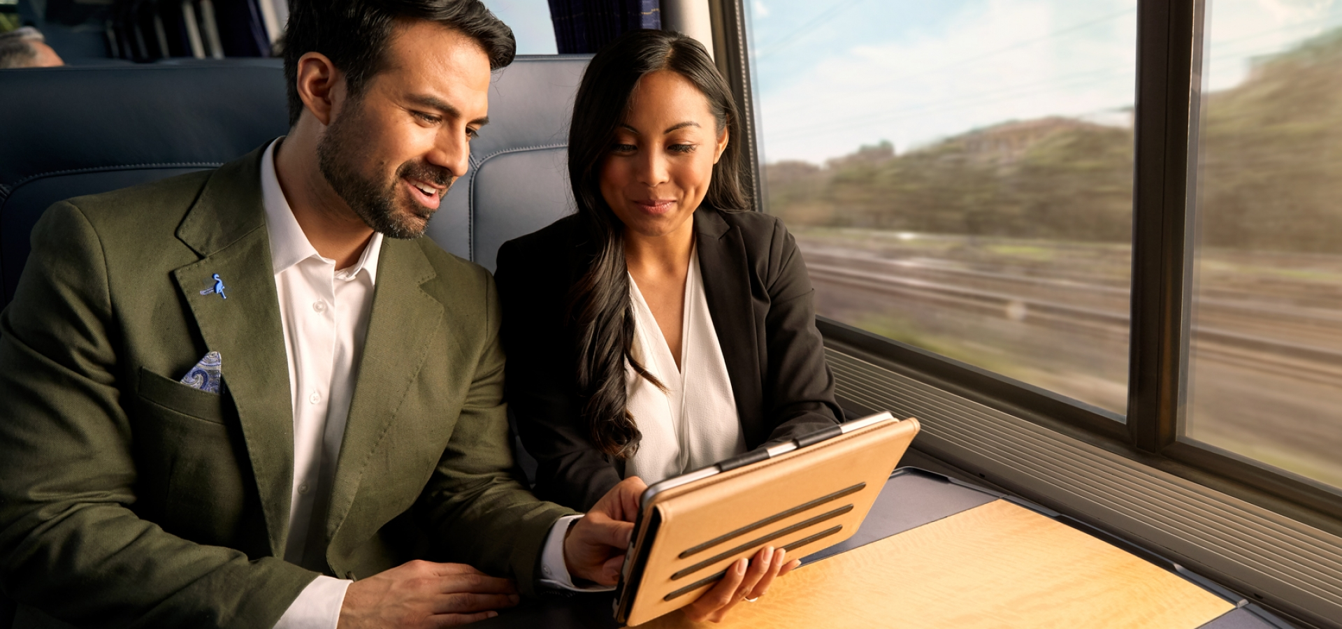 two business people on amtrak's acela train