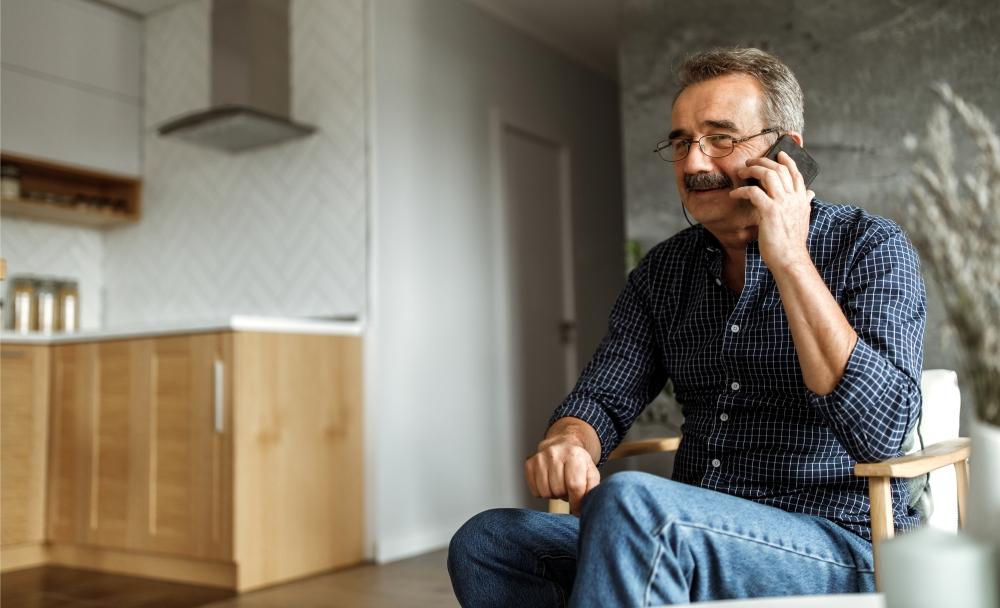 man sitting in room on phone