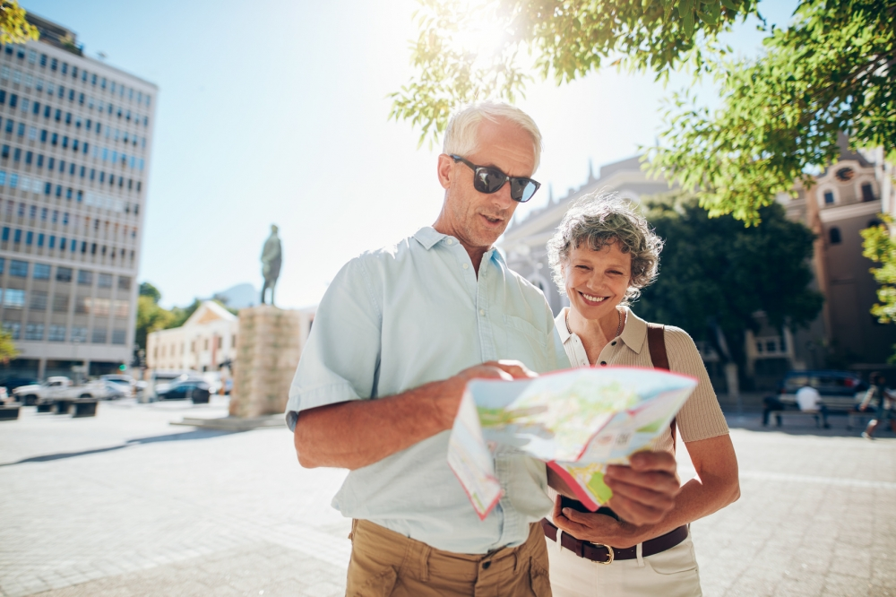 Couple traveling in city with a road map