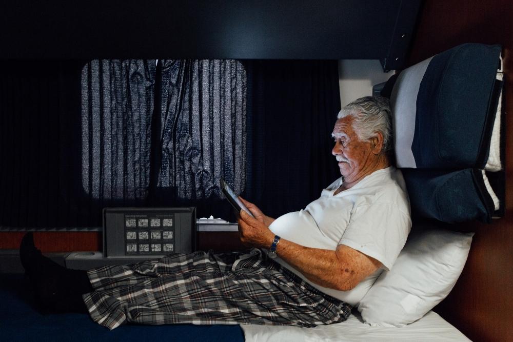 Superliner Bedroom on Amtrak - Senior Man Resting